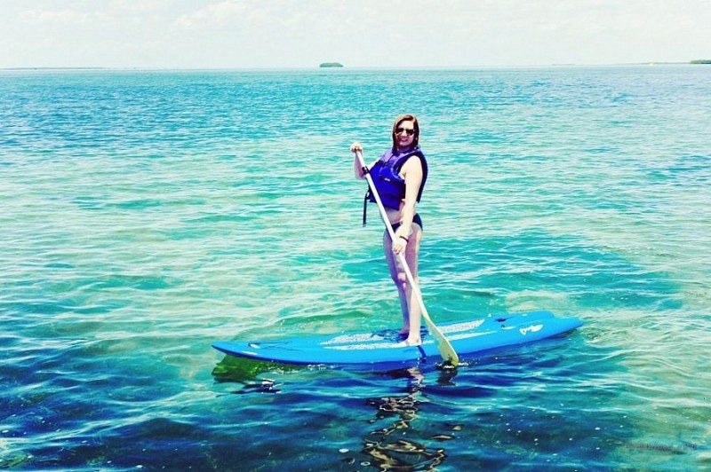 On a paddle board