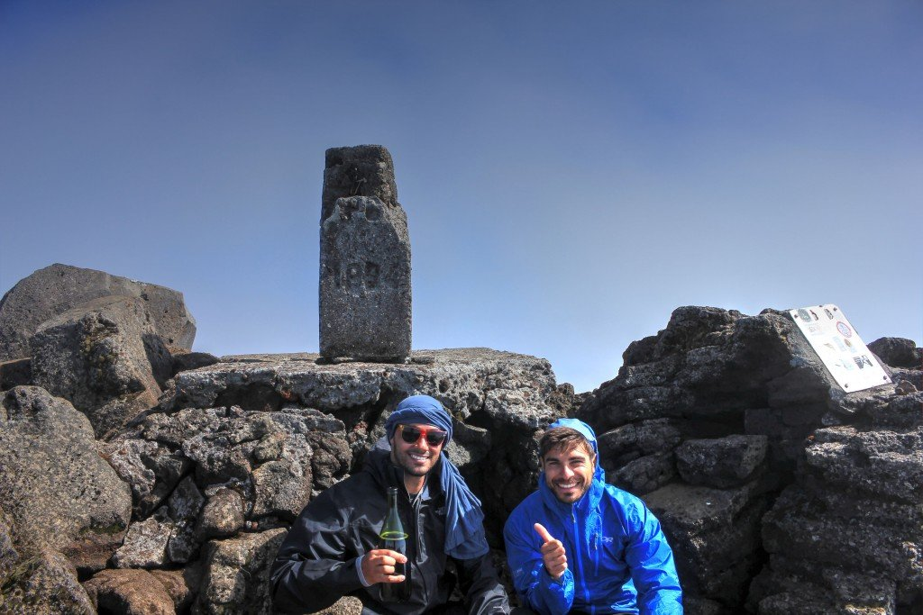 Jonny and I celebrating at the top of Pico's Pico of Volcano Pico with wine
