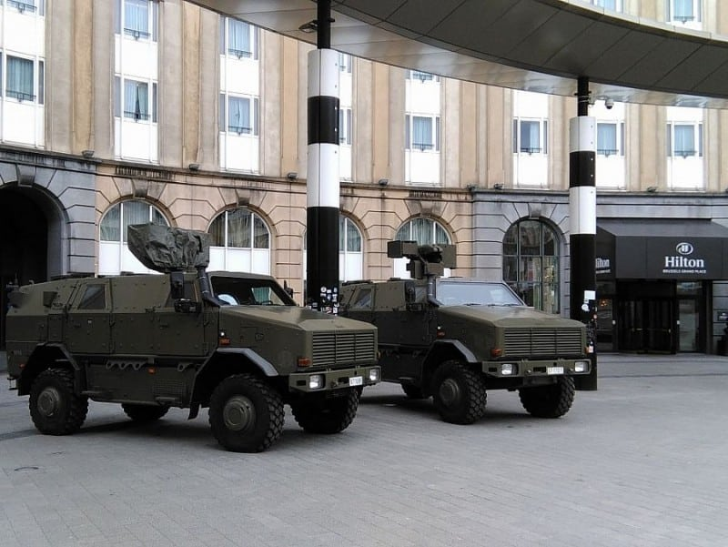 army trucks in front of the Hilton hotel