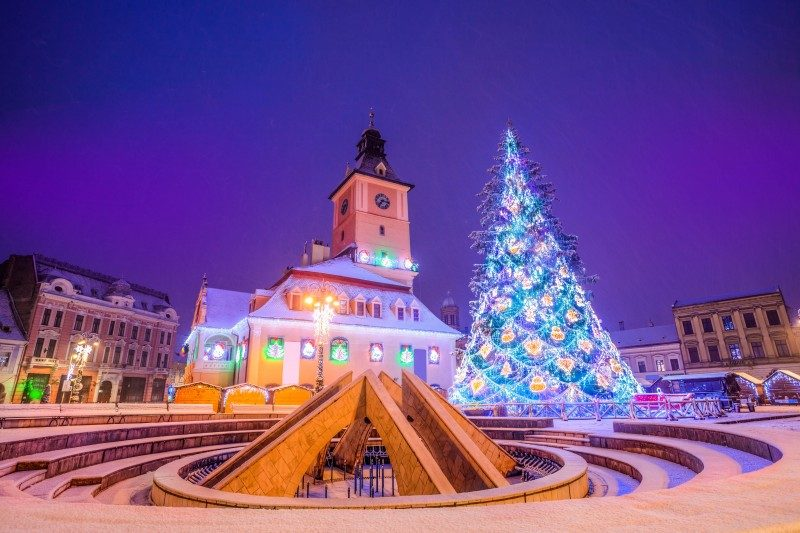 Beautiful Christmas tree near Council house in the main center square of Brasov, Romania - Global Storybook