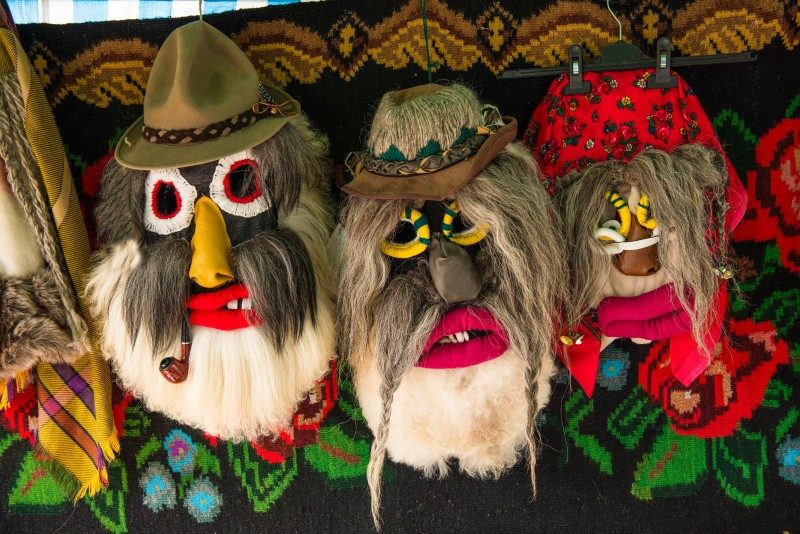 Traditional Christmas carnival masks. Bucovina, Romania - Global Storybook