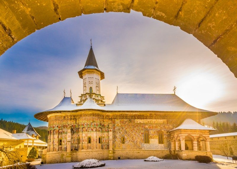 Sucevita orthodox painted church monastery in winter season, Suceava town, Bucovina, Romania - Global Storybook
