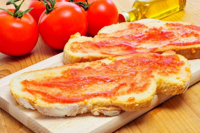 Pa amb tomaquet, bread with tomato, typical of Catalonia, Spain - Global Storybook